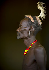 Profile Of A Dassanech Elder Wearing A Feather On His Head, Omorate, Ethiopia (Eric Lafforgue) Tags: africa portrait people color vertical photography necklace day profile helmet feather culture jewelry tribal indoors warrior omovalley inside tradition ethiopia tribe ethnic bun oneperson tribo lookingaway hornofafrica ethnology omo eastafrica thiopien tribesman ethiopie realpeople turkana colorimage darkbackground waistup 9688  omorate africanethnicity pastoralist ethiopi  dassanech etiopien etipia   snnpr    daasanach daasanech oneadult    southernnationsnationalitiesandpeoplesregion clayhelmet ethiopianethnicity thiopien