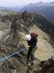 The Bugaboos - Alana Rappelling Eastpost (Tideline to Alpine Photo, Idiosyncrasy Exemplified) Tags: camping sky snow mountains expedition clouds hiking spires adventure climbing alpine mountaineering wilderness rappelling scrambling alpinism bugaboos petzl thebugs alpineclimbing bugabooprovincialpark applebeecamp applebeedome eastpostspire eastpostrappel