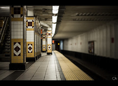 Awkward Silence (Freelensed) (Justin Wolfe) Tags: city railroad light urban cinema blur reflection art philadelphia window glass station yellow speed train canon reflections dark subway tile 50mm lights design moving exposure downtown alone moody quiet graphic artistic centercity cityhall contemporary space empty tracks streetphotography rail tunnel gritty double dirty pa amtrak silence transportation vacant controls mysterious isolation philly septa cinematic urbanism emptiness isolated conductor grungy sterile 215 urbanphotography urbex spacial urbansetting philadelphialight freelens freelensing freelensed phillylight