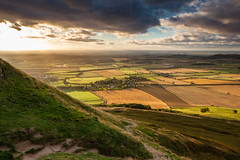 Climbing Roseberry Topping (Daniel Beresford) Tags: uk travel england sky holiday landscape afternoon view unitedkingdom hiking yorkshire vista northyorkshire goldenhour roseberrytopping canoneos5dmarkii reversendgrad canontse24mmf35lii hitechgnd09reverse