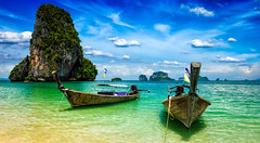 Long tail boats on beach, Thailand (lisame0511) Tags: thailand beach travel tropical boat resort andamansea asia krabi pranang pranangbeach pranangcavebeach railay raileh raylaybeach asian blue boats clean concept group holiday holidays ideal idyllic island letterbox longtailboat longtailboats nature panorama panoramic relax relaxation rock sand sea serene serenity several summertime thai tourism turquoise two vacation water belarus
