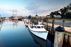 Half Pint (swaltrich1) Tags: sigma nikon nikond7000 sigma14mm workboat easternshore stillness sea morning water reflection sky fishingboat morninglight harbor chesapeakebay capecharlesvirginia wwwbayphotoscom
