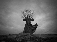The Coronation (Maren Klemp) Tags: fineartphotography fineartphotographer darkart darkartphotography fineart branches crown nature outdoors blackandwhite monochrome surreal conceptual selfportrait evocative ethereal painterly dreamy fairytale woman longdress sky clouds dramatic prints