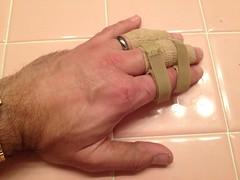 Injured finger (john.watne) Tags: pink usa broken minnesota tile bathroom hands hand crash finger middlefinger injury tendon damage bone swollen mn lefthand injured richfield