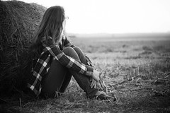 Dawn (Samantha Stock) Tags: blackandwhite girl monochrome grass project 50mm glasses sony jeans toms plaid haybale 366 ismyhappyplace nex5 prideandprejudice3