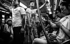In Transit (Beijing) (Daan L) Tags: life china street city summer people urban white black travelling monochrome june juni digital underground subway mono noir traffic metro candid 4 chinese beijing strangers culture documentary july social human metropolis commuting gr juli chinois schwartz zwart wit weiss iv blanc ricoh stad peking commuters 2012 mobility straat ov chinees absorption intransit pekin zhongguo forenzen richohgrdigitaliv daanl