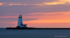Half the pleasure of solitude comes from having with us some friend to whom we can say how sweet solitude is. William Jay (Craig - S) Tags: sunset sky lighthouse color tourism photography pier solitude michigan tourist lakemichigan canon5d ludingtonmichigan northbreakwater ludingtonmi pierlighthouse craigsterken