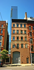 Marine Engine Specialities Corp. (Franthropologist) Tags: door old city nyc newyorkcity urban panorama ny newyork building brick history architecture paint stitch manhattan soho cityscapes fading ghostsign verticalstitch marineenginespecialitiescorp