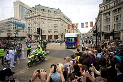 Paralympic Torch Convoy at Oxford Circus (Prestige Pictures) Tags: camera england london crowd police flags anticipation oxfordcircus paralympics disability torchrelay expectation london2012 075 24hourrelay 076 mediatruck lighttheway policemotorcyclist securityofficials 24hourtorchrelay