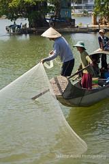 Net throwing in Hue 2 (3 photos) (NettyA) Tags: travel family net canon boat fishing fisherman asia vietnamese vietnam southeast hue throwing perfumeriver eos550d