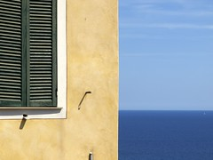 Italian style (Lumase) Tags: blue sea summer sky italy holiday building window topf25 architecture italian estate geometry liguria geometrical cervo rigorous supershot