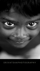 One in a million :) (srivatsaa) Tags: life lighting portrait people blackandwhite india smile clouds photography village child tamilnadu southindia oneinamillion cwc 500d canon500d childportrait incredibleindia srivatsaa chennaiweekendclickers chennaweekendclickers srivatsaaphotography srivatsansankaran srivatsansankara