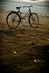 338/365. I Stand. (Anant N S) Tags: street brown india bike bicycle photography 50mm alone mud earth streetphotography dirt cycle lonely nikkor pune pun istand project365 nikond3000 lensor anantns thelensor anantnathsharma