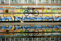 Shoreditch Bike... (Trapac) Tags: city uk blue windows summer england urban streetart reflection london art water lines bike bicycle yellow wall digital graffiti nikon iron colours tag bricks bikes multicoloured tags bicycles hoarding cycle shoreditch walls graff puddles railings locked 2012 cycles wmh nikkor3570mm d700 nikond700 tracypackerphotography wwwtracypackercom