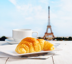 Cup of coffee and croissant in Paris (CampusFrance) Tags: croissant breakfast food bread pastry nobody bakery cup snack morning drink paris coffee table meal closeup delicious restaurant france sweet dessert white cake french cafe object eiffel background fresh tasty tower hot europe travel beverage wooden retro bun romantic tour bake european plate cappuccino cuisine