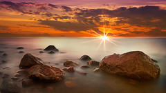 Red sunset on foggy rocks (Bernhard Sitzwohl) Tags: sea salt saltwater brandung meer ostsee nebel sonnenuntergang natur landschaft sonnenstrahlen gischt felsen rocks ocean heiligendamm north germany leefilter longexposure red sunset ozean brown braun wet
