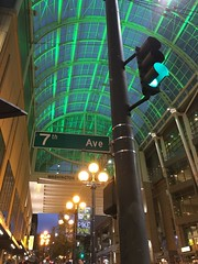7th Ave street sign + signal + Pike Pine banner - under the convention center canopy (Seattle Department of Transportation) Tags: 7th ave street sign signal pike pine banner convention center canopy green glass light cool seattle sdot transportation downtown night