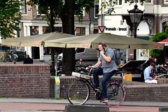 Calling Elvis (FaceMePLS) Tags: amsterdam nederland thenetherlands facemepls nikond5500 straatfotografie streetphotography tweewieler fiets bike bicycle fietser gsm handy smartphone smartfoon gazelle sneakers rugzak transportfiets man telefoon mobieltje