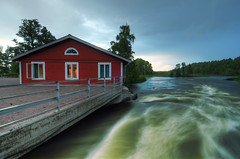Cabin by the Stream (Henrik Sundholm.) Tags: trees windows red lake rain clouds landscape concrete cabin stream open sweden cable shutter sverige railing raining hdr eskilstuna speeds waterscape eskilstunan vilsta skjulsta skjulstastugan