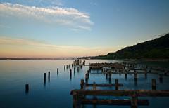 Along the Shore, Tacoma (tacoma290) Tags: city sky mountains clouds bay nikon shoreline bisque pacificnorthwest pugetsound pilings hillside pnw lobstershop commencementbay alongtheshoretacoma slightlongexposure haveyoutriedthebisque