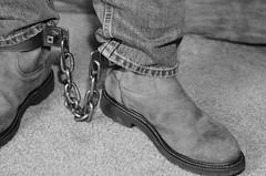 DSC_4893 (jakewolf21) Tags: bw monochrome chains cowboy boots jeans western soles cuffs chained ariat legirons