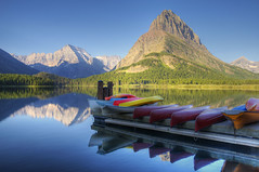 Mountain Recreation (dbushue) Tags: morning lake mountains nature reflections landscape dock nikon peaceful calm canoes glaciernationalpark peaks tranquil 2012 coth swiftcurrentlake supershot absolutelystunningscapes d7000 damniwishidtakenthat coth5 photocontesttnc12 dailynaturetnc12 sunrays5