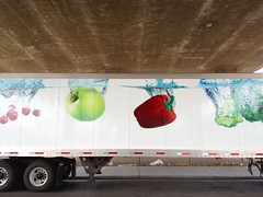 Manna From Above (misterbigidea) Tags: street city urban food vegetables fruit truck advertising landscape concrete view trucker cement drop fromabove semi american delivery roadside grocery splash carepackage heavenly heavensent manna dropping undertheoverpass