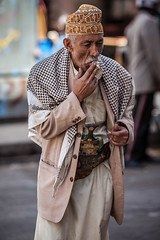 portrait of a smoke man with his Jambiya (جنبية) in the old city Sana'a-Yemen-اليمن-صنعاء (anthony pappone photography) Tags: world pictures travel people digital canon lens photography photo republic foto image smoke picture culture unesco arabia yemen fotografia sanaa ramadan reportage photograher sejima suk arabo yemeni phototravel yaman arabie arabiafelix arabieheureuse اليمن arabianpeninsula يمني صنعاء 也門 йемен جنبية 공화국 υεμένη alyaman yemenpicture yemenpictures eos5dmarkii 아랍 यमन 예멘