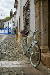 Old bike in Obidos | Portugal (Stefan Cioata) Tags: street old travel houses summer vacation holiday detail portugal colors beautiful bike photography town photo site nikon scenery europe image sale pavement empty exploring details great stock scene medieval best stefan cobblestone explore getty destination obidos top10 available d800 outstanding touristical cioata flickrandroidapp:filter=none