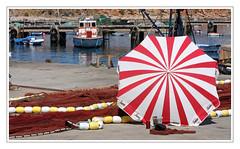 Sur le port de Lagos -  In the port of Lagos (diaph76) Tags: portugal pche paysage landscape bateaux boats filets netting parasol beachumbrella port eaudemer seawater extrieur