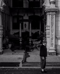anticipation of a lonely man. (tayjhen) Tags: man old nyc new york city newyorkcity oldman bw portrait ruleofthirds rule thirds happy sad love monochrome blackandwhite road architecture column outdoor outdoors