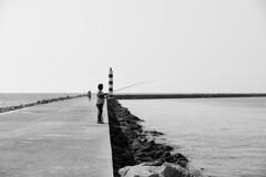 Lone Fisherman (Miguel_Vilhena) Tags: black white preto e branco monochrome fisherman fishermen monocromtico d7200 sigma 1750mm ilha do farol algarve olho faro fotografia mar pesca pescador bicicleta bicycle