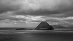 Smoking Island (Aymeric Gouin) Tags: faroe faroeislands fro ilesfro froyar nature seascape sea mer ocean atlantique atlantic island koltur monochrome black white noir blanc nuage cloud europe northerneurope cliff falaise travel voyage olympus omd em10 aymgo aymericgouin