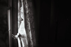 27/365 - He's Better at Seeking (kate.millerwilson) Tags: hideandseek child portrait window curtain blackandwhite monochrome negativespace shadow play naturallight light person people hide contrast