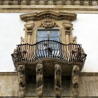 A window and wrought-iron balcony, Palazzo Beneventano, Scicli, Sicily