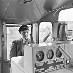 Driver, A. McGrath, 46 Mile cabin, Co. Westmeath. (National Library of Ireland on The Commons) Tags: jamespodea odeaphotographiccollection nationallibraryofireland driveramcgrath cie irishrailways westmeath diesellocomotive engine driverscab locationidentified mcgrath 121class flyingsnail iarnrdireann driver dials cap countywestmeath cabin 46milesignalcabin locomotive