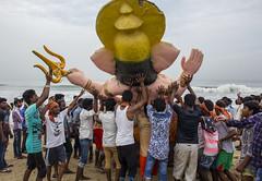 helping hands (Prakash clicks) Tags: ganeshachathurthi marinabeach chennaibeach people hands ganeshaidols group men workship celebration beach
