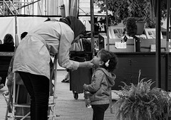 Mother Love (Szoki Adams) Tags: montreal placejacquescartier oldmontreal mother child touching sweet scene kind gentle interaction street streetphotography streetphoto blackandwhite bw earlyfall 2016