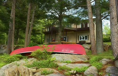 The Red Canoe (Lindaw9) Tags: canoe red trees house rocks plants