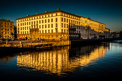 Reflecting A Higher Court (Mabry Campbell) Tags: shadow reflection building water yellow architecture gteborg photography coast canal photo europe sweden gothenburg bluesky coastal photograph commercial 100 sverige february scandinavia canonef1740mmf4lusm 2012 f40 31mm ef1740mmf4lusm sec mabrycampbell february292012 201202293504