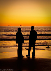 (Greg Adams Photography) Tags: ocean california ca winter sunset sky people orange reflection men beach water silhouette island glasses boat twilight sand rocks waves pacific dusk peaceful conversation southerncalifornia talking coronado hhsc2000