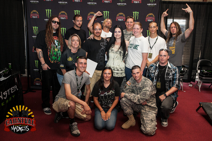 Evanescence thanking our brave troops. Here they are with soldiers from the Wounded Warrior Project in Belton, TX!