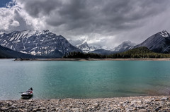Laying low (JoLoLog) Tags: trees lake canada mountains clouds boat alberta rockymountains hdr lorien kananaskiscountry canadianrockies upperkananaskislake kcountry canonxsi