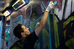 artist (graffitti) at work ('Ollie') Tags: street bw white black streets colour art monochrome wall modern underground grey amazing artist colours grafitti pieces dof mask bokeh sony arts tunnel skills can spray waterloo masks gloves talent hoody artists graffitti latex glove walls cans leake spraycan greyscale skill sprays grafittis a500 graffittis grayscales spraycabs hoodiespiece