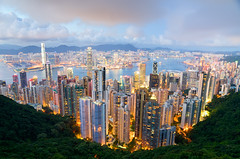 Hong Kong Harbor at Night (andreaskoeberl) Tags: china city longexposure travel blue orange tourism yellow skyline night clouds dark hongkong gold harbor lowlight nikon asia cityscape peak overcast illuminated hong kong glowing bluehour thepeak overlooking hdr victoriapeak 1685 d7000 nikon1685 nikond7000 andreaskoeberl