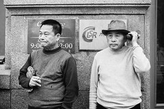 (red line highway) Tags: people street photography nikon city blackandwhite black white russia stpetersburg time social documentary downtown 35mm monochrome men summer hat chinese cigarette two