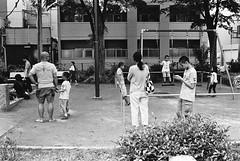 Bunkyo, Tokyo (fabiolug) Tags: playground swing swings kids children kid child trees tree bunkyo people street streetphotography tokyo japan japanese asia leicamp leica mp rangefinder film filmphotography believeinfilm blackandwhite blackwhite bw kodaktrix400 trix400 kodak trix kodaktrix voigtlandernoktonclassic35mmf14 voigtlandernokton35mmf14 voigtlander35mmf14 35mm voigtlander