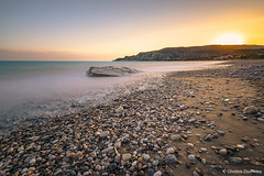 Golden Sunset over Pissouri Bay (Christos Zoumides) Tags: beach sea seascape landscape shore swash bay pebble pebbles longexposure waves filters leefilters sw150markii sw150 bigstopper blue yellow sunset goldenhour europe southeurope mediterranean mediterraneanregion mediterraneansea cyprus limassol lemesos pissouri pissouribay nikon nikond750 nikon1424mm nationalgeographic ngc nature rock tranquillity outdoor sky summer holidays relax