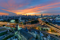 Bangkok City downtown and road interchanged after sunset (wichianduangsri) Tags: bangkok freeway way trails aerial junction express cloud view intersection flow business urban traffic curve night overpass skyline route light highway evening glow dusk twilight interchange crossing bypass building busy nightfall modern elevated transport motorway flyover architecture city blue speed sunset transportation movement background bridge road quick fast china cityscape