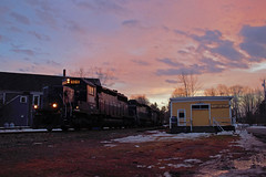 POWA at Sunset (jc_canon) Tags: monmouth monmouthmaine maine train freighttrain powa freighthouse freightshed sunset panamrailways panam winter sundown nightfall dusk evening emd emdsd402 sd402 mec606 snoot